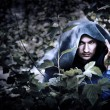 Постер, плакат: Mystery man in raincoat with hood