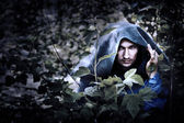 Mystery man in raincoat with hood — Stock Photo