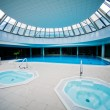 Indoor swimming pool with jacuzzi — Stock Photo
