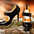 Fashion female shoes on a high heel - Stock Photo