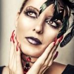 Fashion portrait of female vampire — Stock Photo #12387060