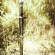 Sword in ground — Stock Photo