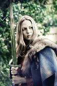 Woman warrior with sword — Stock Photo