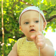 Beautiful baby girl in hat outdoor on summer green trees backgro — Stock Photo