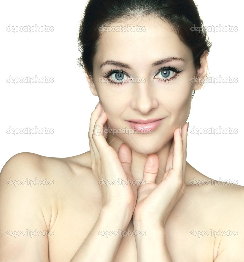 Beautiful woman holding hands at beauty clean face. Closeup isolated portrait on white background  Stock Photo #12338525