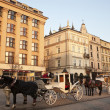 Horse carts on the Main Market Square of Krakow - Stok fotoğraf