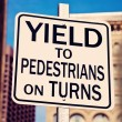Stock Photo: Yield on pedestrians on turns
