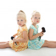 Twins with make-up brushes — Stock Photo