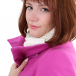 Cute woman in pink coat over white — Stock Photo