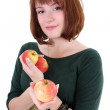 Stock Photo: Cute woman with apples isolated over white background