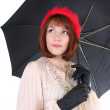 Cute woman with umbrella dreaming — Stock Photo