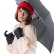 Young cute woman with umbrella over white — Stock Photo