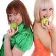 Two young attractive women with green apples — Stock Photo