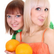 Two young attractive women with oranges — Stock Photo