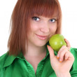 Young attractive red-haired woman with green apple — Stock Photo #11791062