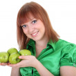Young attractive red-haired woman with green apples — Stock Photo