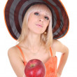 Young attractive woman in hat giving red apple — Stock Photo