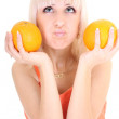 Young attractive woman with two oranges — Stock Photo #11791072