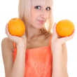 Young attractive woman with two oranges — Stock Photo