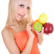 Attractive blonde with apples, lemon and orange — Stock Photo
