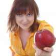 Young attractive woman with red apple. apple in focus — Stock Photo