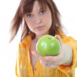 Young attractive woman with green apple. apple in focus — Stock Photo