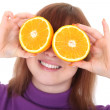 Red-haired woman with two orange slices instead of eyes — Stock Photo