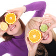 Two funny women with orange and lime slices instead of eyes — Stock Photo