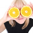 Funny blonde with two orange slices instead of eyes — Stock Photo