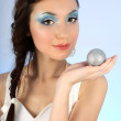 Beautiful woman with christmas tree ball — Stock Photo