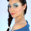 Stock Photo: Attractive woman in blue with make-up