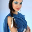 Portrait of beautiful woman with blue make-up — Stock fotografie