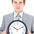 Young businessman holding a clock — Stock Photo #11791334