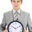 Young businessman holding a clock — Stock Photo #11791340