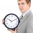 Young businessman holding a clock — Stock Photo #11791341