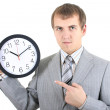 Young businessman holding a clock — Stock Photo #11791348