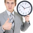 Young businessman holding a clock — Stock Photo