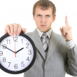 Young businessman holding a clock — Stock Photo #11791358