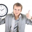 Stock Photo: Happy businessman holding a clock