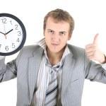 Happy businessman holding a clock — Stock Photo #11791380