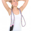 Sporty woman with jump rope isolated over white — Stock Photo