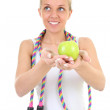 Stock Photo: Dreaming girl with skipping rope and apple
