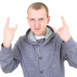 Young man doing a rock and roll symbol - Stock Photo