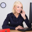 Woman in the office on the phone — Stock Photo #11791704
