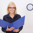 Attractive bookkeper with folder — Stock Photo #11791713