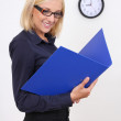 Attractive businesswoman with folders — Stock Photo