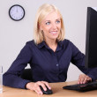 Businesswoman in the office — Stock Photo #11791716