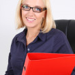 Blondie businesswoman with folders — Stock Photo