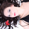 Brunette with red lips lying — Stock Photo