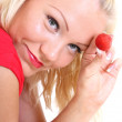 Blonde in red showing strawberry — Stock Photo